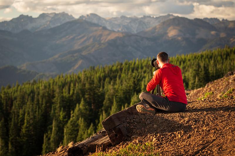 Kittitas, Red Top - Photographer on ridge shooting a distant mountain scene