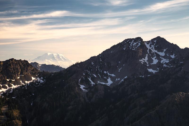 Stuart, Ingalls - Mt. Rainier above a distant ridgeline