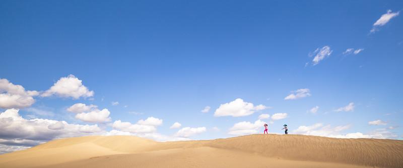 Columbia, Mattawa - Two kids enjoying the sand dunes at Hanford Reach