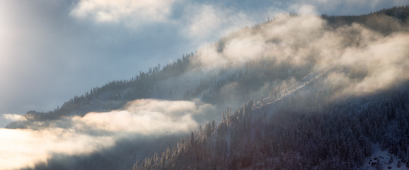 Leavenworth, Town - Distant hillside covered in snow with clouds