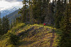 Kittitas, Kachess Beacon - Photographer in red jacket on trail near flowers