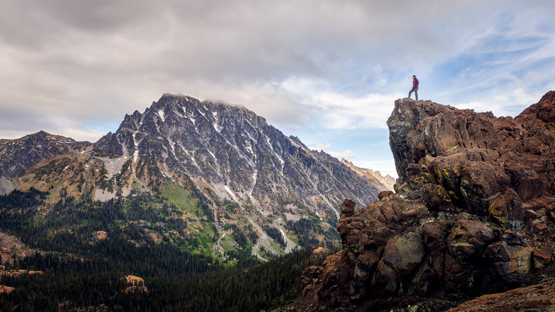 Stuart, Ingalls - Man on rock overlooking valley below Mt. Stuart