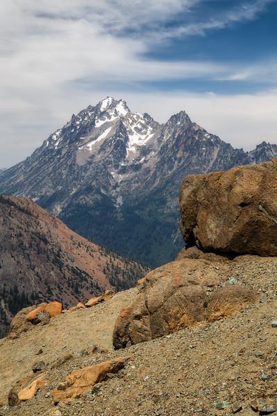 Kittitas, Bean Creek - Mt. Stuart framed by large boulders on a ridge near Bean Peak