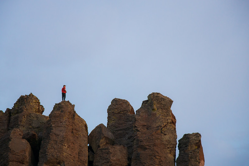 Columbia, Vantage - Climber on summit of basalt column at sunset