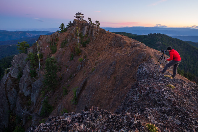 Kittitas, Red Top - Photographer on ridge at sunset with lookout in background
