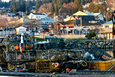 Crab traps on boat in harbor.  Downtown in background