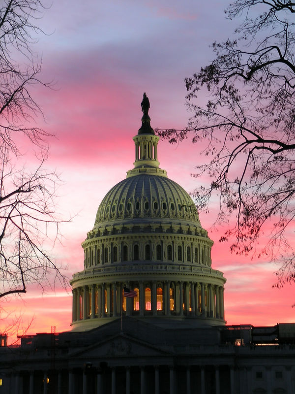 The sun sets over the U.S. Capitol a day after drilling in ANWR was defeated in the Senate