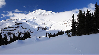 I chose the perfect day to snow shoe up to Mount Rainier, the skies were stunning.  I followed some tracks up to a ridge which had stunning 360 degree views.  I handheld this video and tried to be fluid, but that is just not possible on snow shoes!  I almost made it all of the way around!
