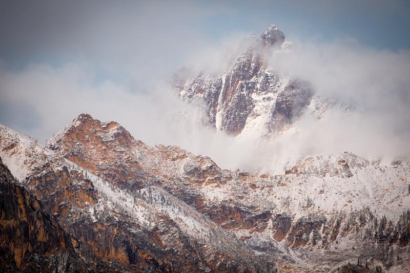 Rainy Pass. Maple Pass - Distant peak and ridge in the snow and fog