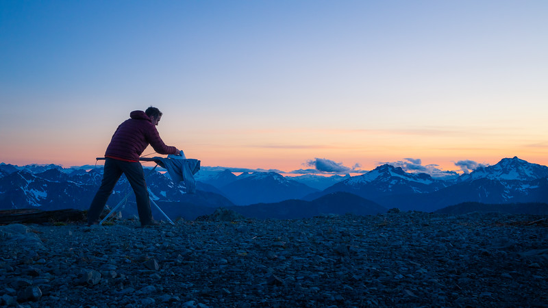 Harts Pass, Slate Peak - Man ironing with distant peaks after sunset, looking right