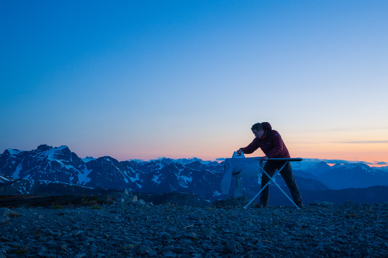 Harts Pass, Slate Peak - Man ironing with distant peaks after sunset, looking left