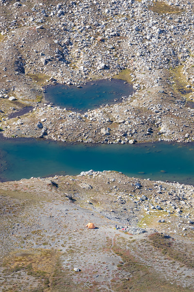 Whatcom, Yellow Aster Butte - Aerial view of heart shaped lake in basin with small yellow tent nearby