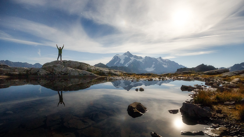 Whatcom, Artist Point - Man with hands up by lake under moonlight with Mt Shuksan