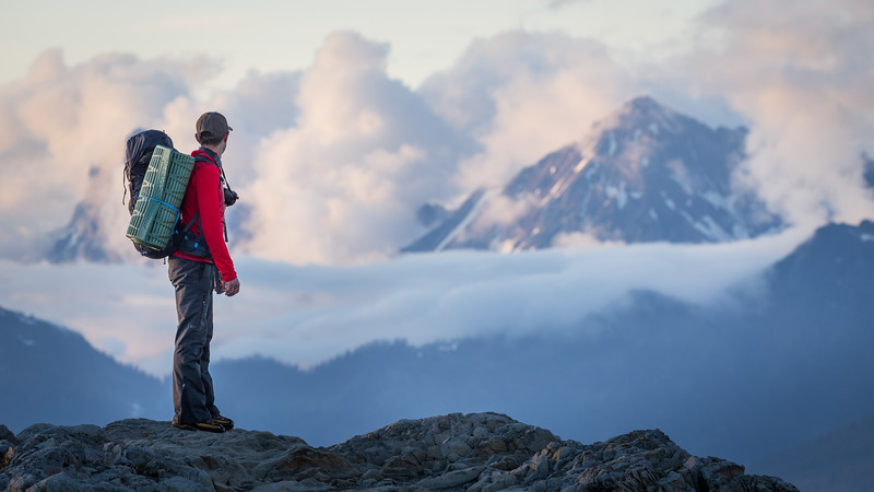 Whatcom, Artist Point - Hiker on ridge overlooking mountain with clouds
