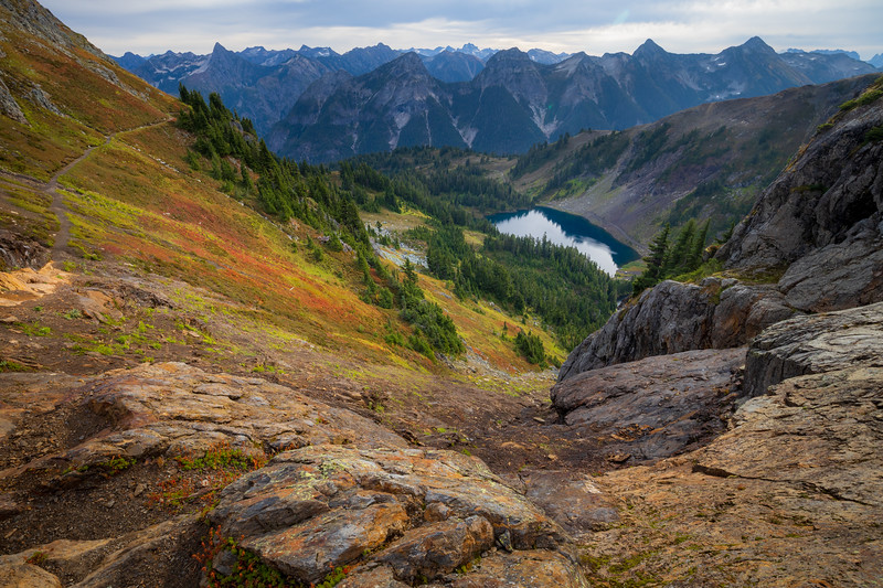 Whatcom, Winchester Mountain - Rock vortex with colorful bushes, trail, and lake