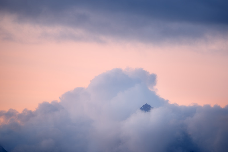 Whatcom, Artist Point - Top of mountain peeking through clouds at sunset