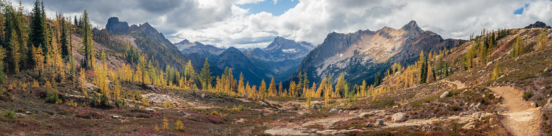 Rainy Pass, Cutthroat Pass - Panoramic view of Porcupine Creek valley with trail, larch, and named peaks Cutthroat, Corteo, and Porcupine