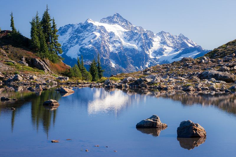 Whatcom, Yellow Aster Butte - Mt. Shuksan above a lake with rocks