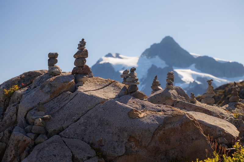 Whatcom, Artist Point - Numerous rock cairns on a small hill with Mt. Shuksan in the distance