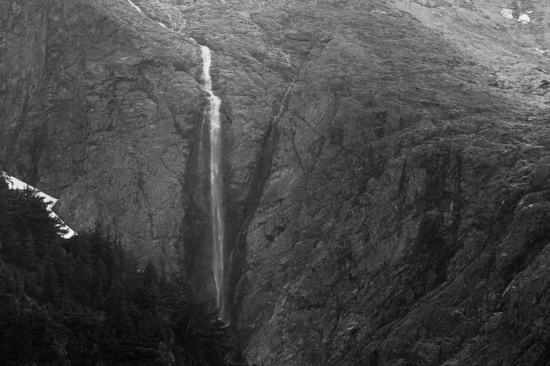 North Cascades, Cascade Pass - Waterfall falling off of bare rock beneath Johannesburg Mountain