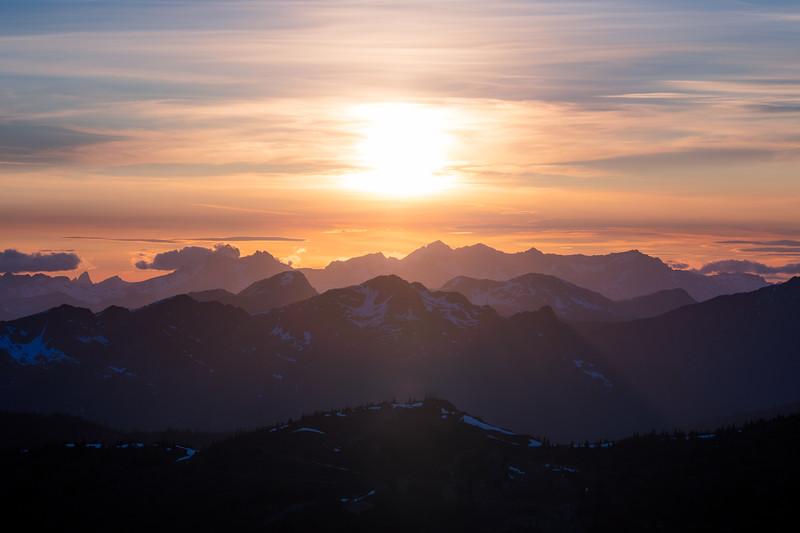 Harts Pass, Slate Peak - Sun setting over distant peaks and layered ridges, wider
