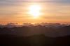 Harts Pass, Slate Peak - Sun setting over distant peaks and layered ridges