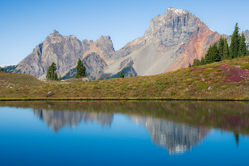 Whatcom, Yellow Aster Butte - American and Canadian Border Peaks reflected in lake