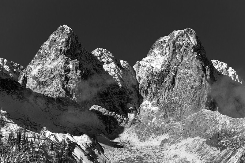 Rainy Pass. Maple Pass - Two imposing mountain peaks in the snow, black and white
