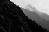 Rainy Pass, Cutthroat Pass - Layers of distant peaks in clouds and mist, black and white
