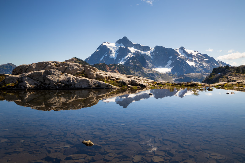 Whatcom, Artist Point - Pond ringed by rocks with Mt. Shuksan on a sunny day