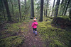 North Cascades, Newhalem - Little girl in pink coat walking through forest
