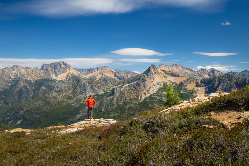 Rainy Pass, Cutthroat Pass - Man standing looking over valley at Silver Star and Hinkhouse Peaks