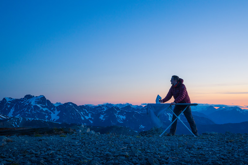 Harts Pass, Slate Peak - Man ironing with distant peaks after sunset, looking up at view