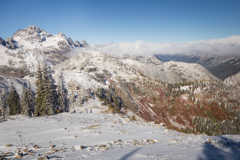 Rainy Pass. Maple Pass - View towards Maple Pass from above, with snow at the pass and fall colors below, tighter angle