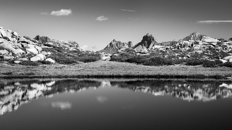 Whatcom, Artist Point - Distant peaks including Larrabee and Yellow Aster Butte and a shoreline reflection, black and white