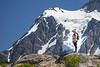 Whatcom, Artist Point - Woman hiker on ridge with Shuksan in background