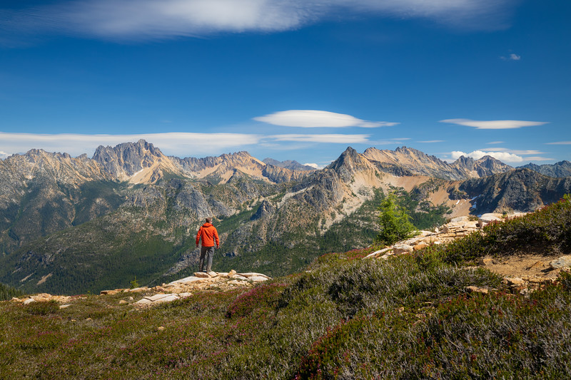 Rainy Pass, Cutthroat Pass - Man standing looking over valley at Silver Star and Hinkhouse Peaks, alternate position
