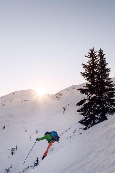 Whatcom, Baker Ski Area - Skier descending a slope at sunrise