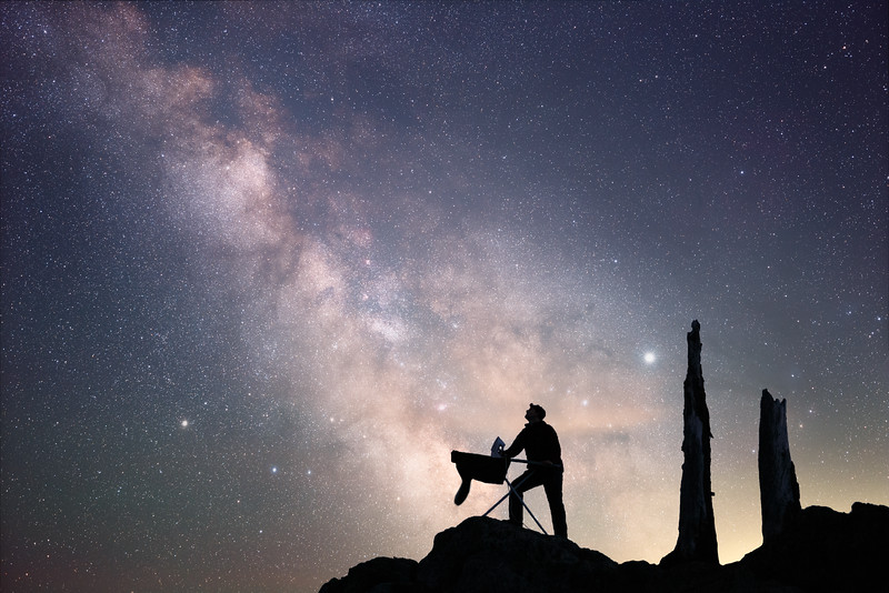 Whatcom, Artist Point - Man ironing under Milky Way with two old trees