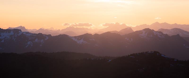 Harts Pass, Slate Peak - Sun descending above layers of mountains
