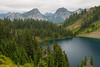 Whatcom, Winchester Mountain - Upper Twin Lake surrounded by forest with mountains in the background