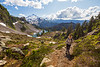 Whatcom, Artist Point - Female hiker climbing trail above Iceberg Lake with Baker in background