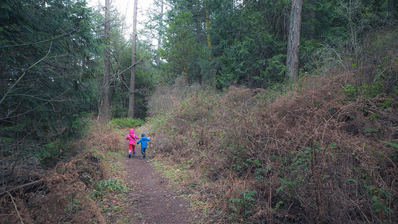 Skagit, Kukutali Preserve - Two little kids running down the trail