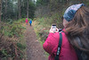 Skagit, Kukutali Preserve - Woman with cell phone taking picture of kids on hiking trail