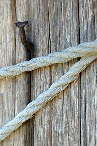 Nail and Rope on a Wooden Post