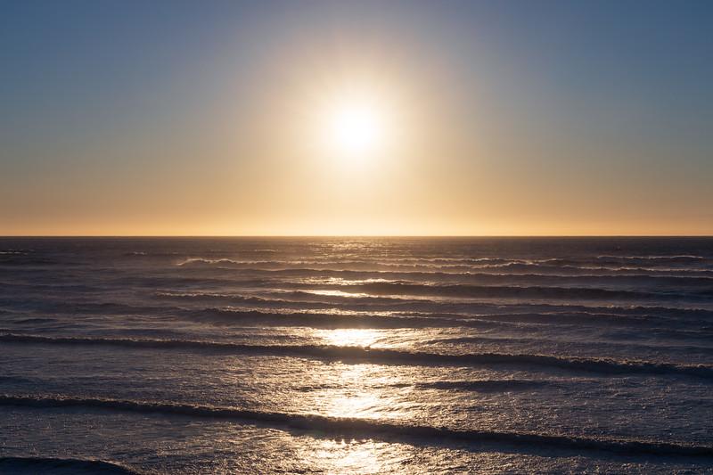 Kalaloch, Beach 1 - Sun setting over waves in clear sky
