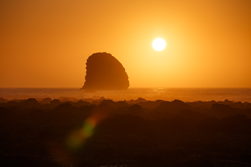 Olympic NP, Ozette Coast - Intense orange sunset with distant sea stack