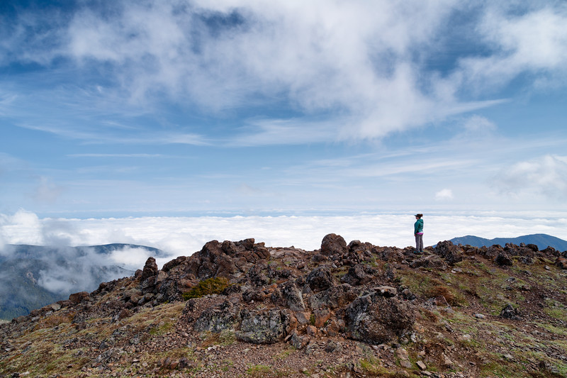 Quilcene, Mt. Townsend - Woman standing on ridge above an inversion layer