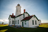 Sequim, Dungeness Spit - Lighthouse with sun behind it
