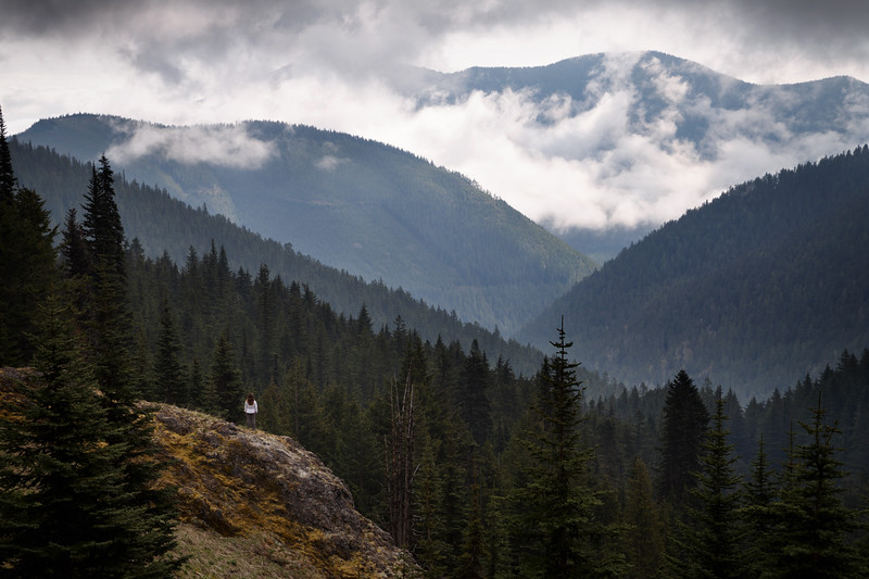 Quilcene, Mt. Townsend - Woman on edge of cliff overlooking foggy valley